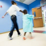 Photo of patient walking through the hallways