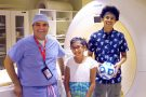 Karun Sharma, M.D., poses with two patients