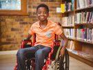 boy sitting in wheelchair