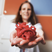 Dr. Laura Olivieri holding a 3D printed heart