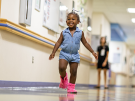 little girl in hosptial corridor