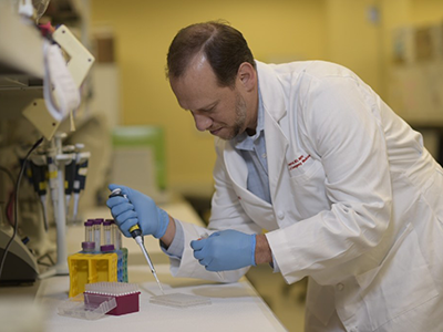 Robert J. Freishtat working in the lab