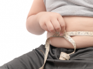 child measuring his stomach