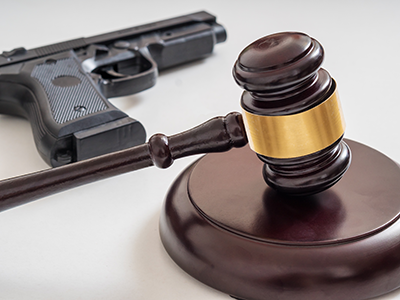 Gavel in front of a pistol