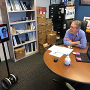Karin S. Walsh, Psy.D., and Gerard Gioia, Ph.D., in the Division of Neuropsychology pilot robotic telepresence technology to improve video visits.