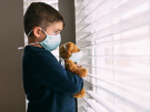 young boy and teddy bear in face masks