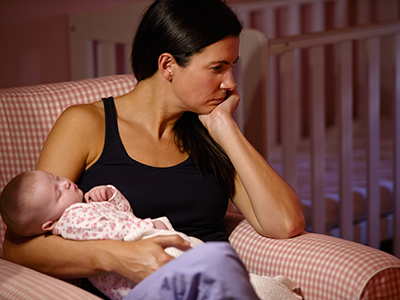 depressed mom holding baby