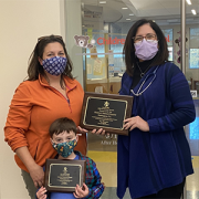 Mended Little Hearts' Volunteer of the Year, Maryann Mayhood, and her son Joseph delivered the Hospital of the Year award to Dr. Donofrio in November 2020.