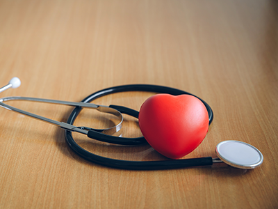 stethoscope and stress ball in heart shape