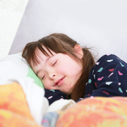 girl with down syndrome sleeping