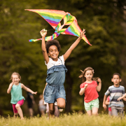 happy children running with kite