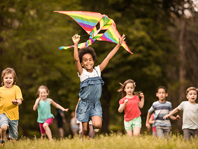 happy children running with kite