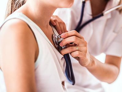 doctor listening to girl's heart