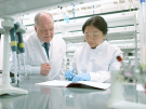 Dr. Eric Vilain and researcher in a lab