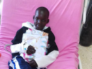 Ugandan boy in hospital bed