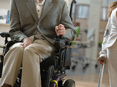 Midsection of a handicapped man and woman